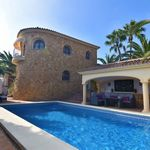 A 4 bedroom villa in Moraira-Teulada, Costa Blanca, with private pool and sea views, just 1.6 km from the beach.