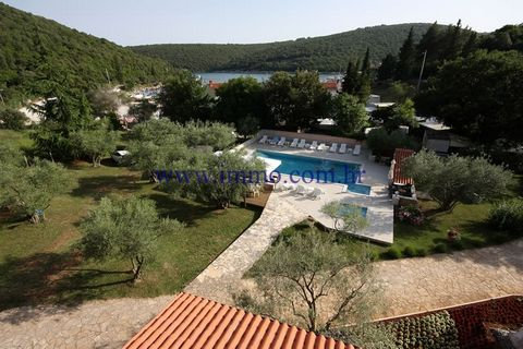 A family hotel of 1634 sq.m. for sale, located in south-east coast of Istria, 25 km away from Pula. It is situated on the land of 2809 sq.m., only 200 m from the sea. This hotel was built in 1997 and has 3-star rating. It consists of 29 rooms, a rest...