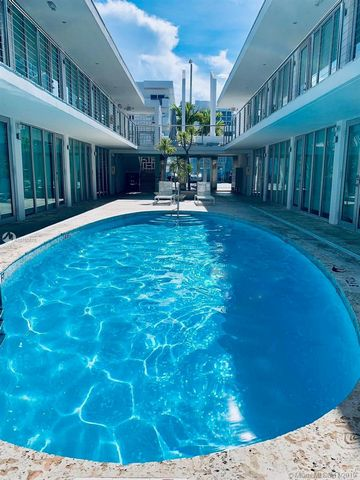 Renovated Mid-Century Modern one bedroom one bathroom condominium in the heart of South Beach with low monthly HOA costs and taxes. The unit features hurricane resistant floor-to-ceiling windows with southern exposure, new central air conditioning, m...