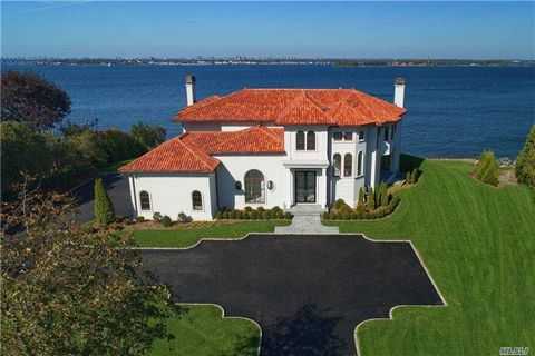 BREATHTAKING WATERFRONT OFFERING Expansive water views of the Long Island Sound, Manhattan, Throgs Neck Bridge, Westchester and Connecticut may be enjoyed year round within this elegant new construction in the Prestigious Village of Kings Point. Priv...