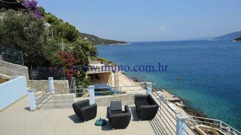 LUXURY SEAFRONT VILLA NEAR TROGIR Gorgeous luxury villa for sale, located on the seafront in the small village, approx. 15 km from Trogir. It is arranged over the ground floor including a garage of 200 sq.m. and three floors with total living space o...