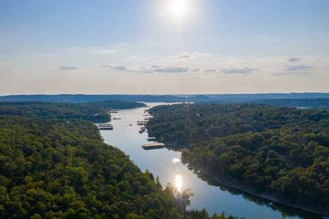 Located in Kimberling City. This property has a ton to offer. If you've been looking for a buildable lot steps from the lake, within 30 minutes of the Ozarks and with views of the Ozark Mountains, this is the place for you. Approximately a half acre,...