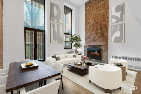 This 3 bedroom + garden duplex with 2 bathrooms is in a beautiful prewar building located on a quiet tree-lined street. South facing duplex apartment featuring a 250 square foot outdoor garden, 17 foot high ceilings, and exposed brick walls. Wood-bur...