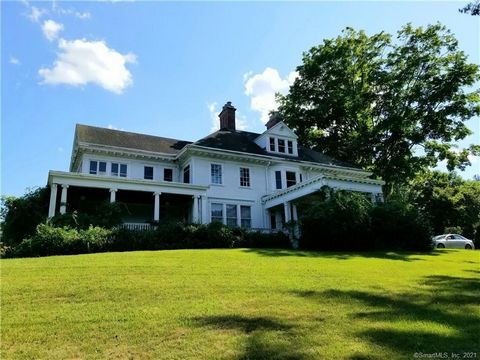 """SELLER MOTIVATED! Known as Oxfordshire, the family homestead of Stephen B. Church is a 10,000+ sf, 2.5 acre landmark is conveniently located in Oxford, CT. The original home dating back to the 1700's was later split into what are now known as the """"Ea..."""