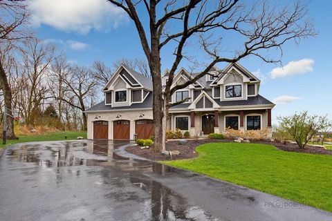 One-of-a-kind home with well-planned layout and unique details throughout! 5 car + lift heated garage with epoxy flooring, finished walkout basement and top-of-the-line appliances and equipment. Every inch of this home is graced with custom finishes....