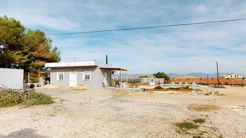 Incredible plot of land located just outside of Orihuela with amazing 360 degree views of the surrounding mountains. The plot consists of 4.350m2 which includes a 50m2 outbuilding that features 2 bathrooms, a modern fully-fitted kitchen and living/di...