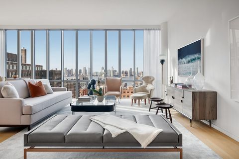From the moment you enter the residence, through a private key-locked elevator, you are met with west water views providing an immediate sense of tranquility. This sun-flooded and stunning 2,519 square foot, four-bedroom condominium with 10-foot ceil...