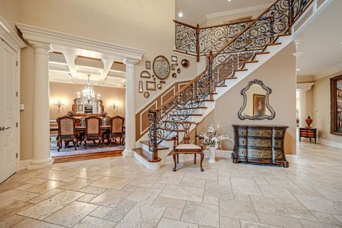 Bask in luxury and live in an artful architectural dream in this custom built 6 bedroom, 6.1 bath lake front home nestled in prestigious North Shore neighborhood. Indulge in elegance in each corner of this fabulous estate, with features including tw...