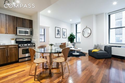Residence 509 located at 1 Wall Street Court is a spacious and bright corner unit offering 2 bedrooms and 2 full bathrooms. An exceptional value at only $947 per square foot! When you walk in, you are welcomed by a large foyer which leads you into th...