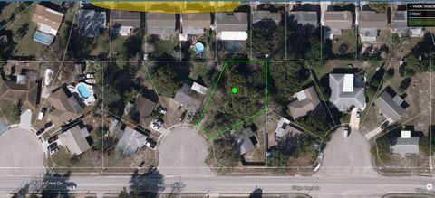 Located in Port Richey. You won't find another beauty like this homesite available in this Port Richey established neighborhood. This .23 acre lot sits on a quiet cul-de-sac on a nice paved road and all utilities are available. The lot is pie-shaped ...
