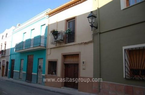 An attractive traditional Town House in the Orba Valley enter through heavy wooden doors into the Lounge with high beamed ceiling with an archway leading to the Dining Room. There is a Woodburning Stove and the chimney passes up to the first floor. T...