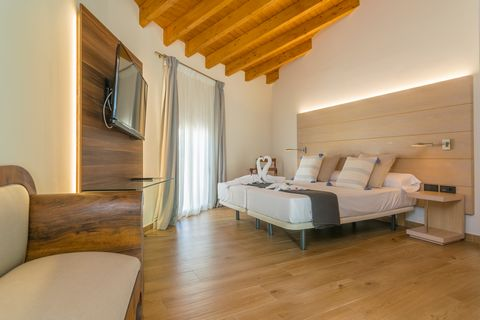We welcome two guests to this fantastic suite bedroom of the impressive inland hotel Central Maria. Hotel Central Maria is perfect to stay those who are lovers of inland villages with great charm.Its incredible suite bedroom offers such great beauty,...