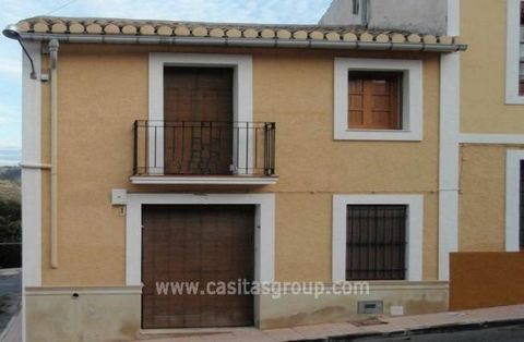 A Town House in Aigues, a lovely town close to Alicante yet in a lovely country location. Tastefuly renovated and in extremely good condition the property is entered via carved wooden doors into a large living/dining room with a feature fireplace an ...