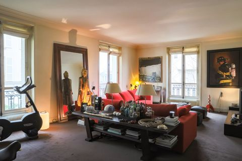 Apartment located in the heart of Saint Germain on Rue du Bac, second floor of a splendid historic building, entrance hall leading to a charming living room, dining room with bar, equipped kitchen, two large bedrooms, bathroom with shower and a large...