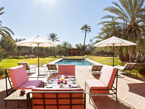 situated in the middle of its lush, surrounding gardens located in the fabled, sun-drenched Palmeraie—a palm oasis of several hundred thousand trees outside the exotic city of Marrakesh, Morocco. A grand entrance courtyard with a fountain and colonna...
