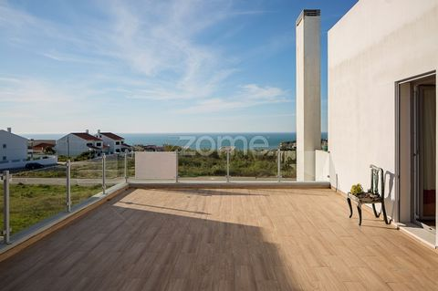 4 bedroom villa in gated community, with sea view. This villa with an excellent location in Ribamar, about 5 minutes from the center of Ericeira, and close to all access and services, distributed over 3 floors. The 0 th floor consists of a large livi...