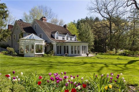 Only a short 35 minutes' to Manhattan, this glorious Harrison estate feels far away in the country... on nearly 12 spectacular acres with stunning architecture, museum quality restorations, and modern-day appointments blend together in this spacious ...